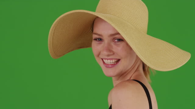 caucasian millennial woman with sunhat smiling laughing in backyard on green screen - blonde hair stock videos & royalty-free footage