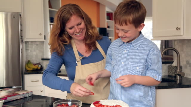 caucasian mother and son decorating cake - food styling stock videos & royalty-free footage