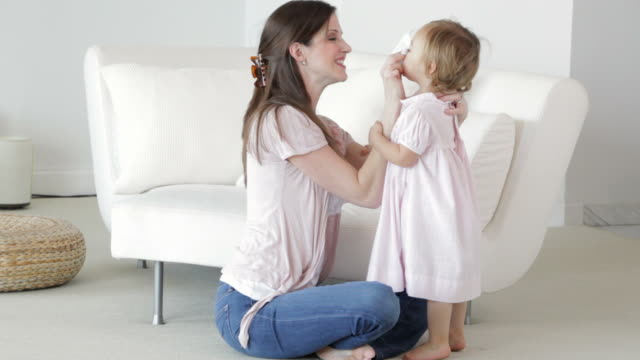 caucasian mother cleaning nose of daughter - nose stock videos & royalty-free footage