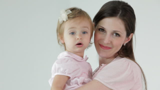 caucasian mother holding daughter - one parent stock videos & royalty-free footage