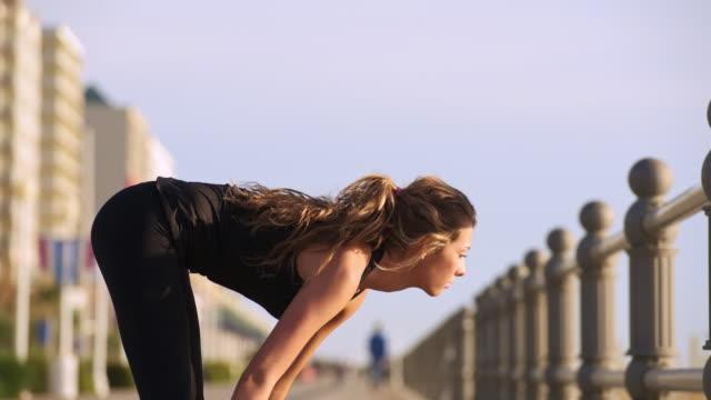 caucasian teenage girl stretching legs on boardwalk - one teenage girl only stock videos & royalty-free footage