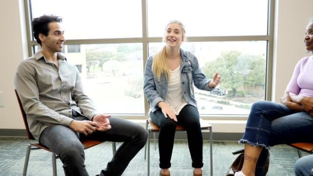 caucasian teenage girl talks about something during group therapy session - community centre stock videos & royalty-free footage