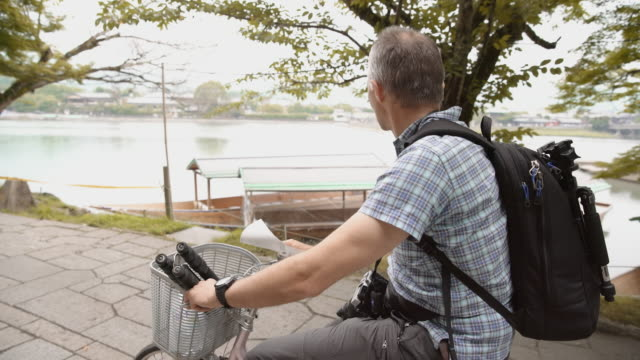 caucasian tourist cycling along the river - 40 44 years stock videos and b-roll footage