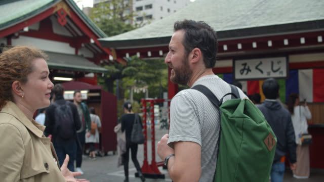 caucasian tourists outside sensō-ji - temple building stock videos & royalty-free footage