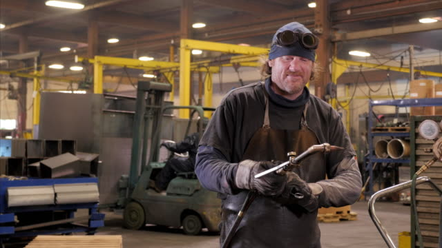caucasian welder igniting torch in metal fabrication facility - metal blend stock videos and b-roll footage