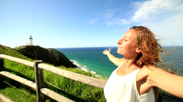 caucasian woman arms outstretched at cape byron - lighthouse stock videos & royalty-free footage