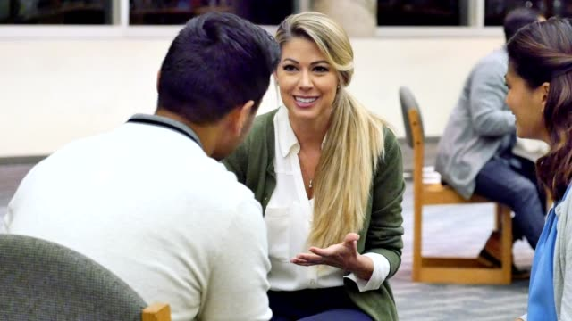 Caucasian woman discusses something during support group meeting