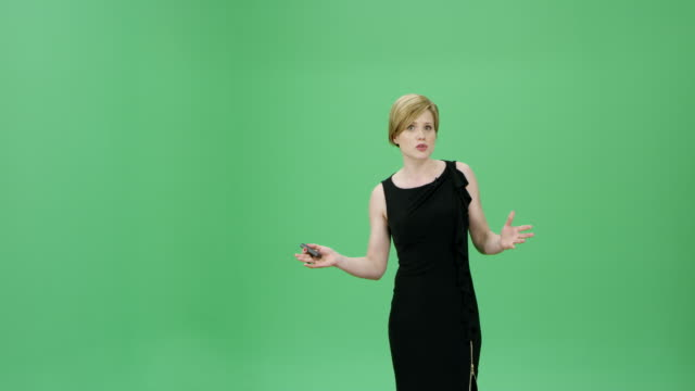 caucasian woman in a black dress talking about the weather forecasts - microphone stock videos and b-roll footage