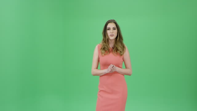 caucasian woman with long brown hair presenting the weather forecast - television chroma key stock videos & royalty-free footage