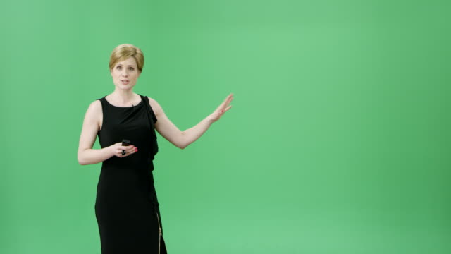 caucasian woman with short blonde hair presenting the weather forecast - presenter stock videos & royalty-free footage
