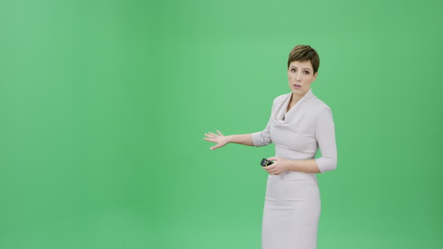 caucasian woman with short hair presenting the weather forecast - explaining stock videos & royalty-free footage