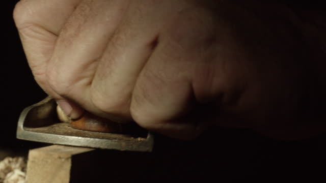 a caucasian woodworker uses a no.5 vintage hand plane along the edge of a red oak board - craftsperson stock videos & royalty-free footage