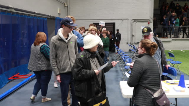 caucus goers are given paper ballots during the iowa caucuses monday february 3 2020 in desmoines iowa - voting ballot stock videos & royalty-free footage