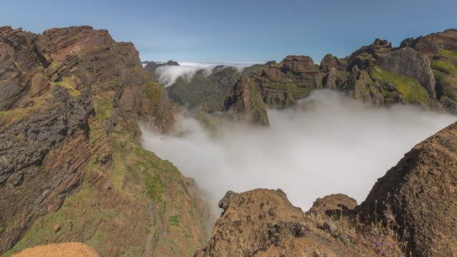 cauldron of boiling clouds below volcanic mountains - madeira stock videos and b-roll footage