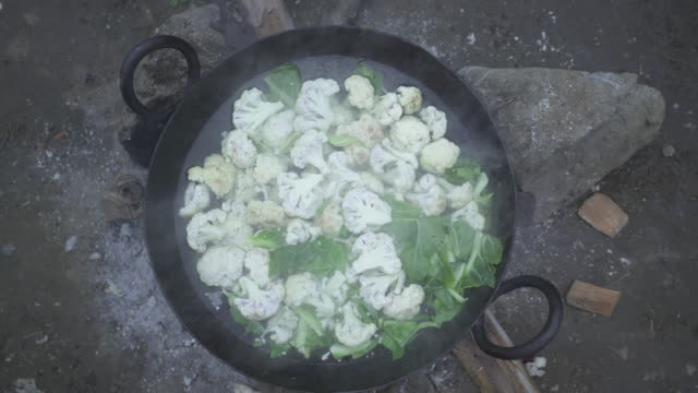 cauliflower and greens steam in pot - cauliflower stock videos & royalty-free footage