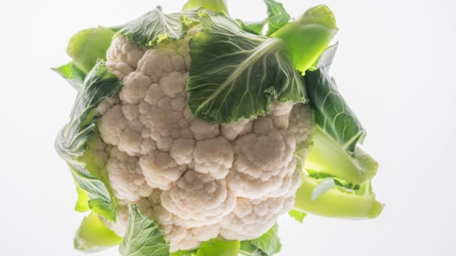 cauliflower isolated on white - cauliflower stock videos & royalty-free footage