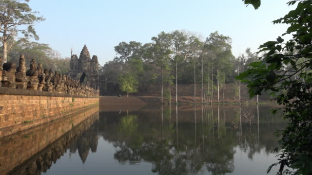 PAN / Causeway across a moat to South Gate, entrance of Angkor Thom