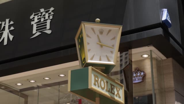 causeway bay hong kong china monday aug 10 2015 shots medium shot a rolex logo is displayed on a spinning above a store on russell street wide shot... - bay window stock videos and b-roll footage