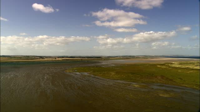 causeway to lindisfarne  - aerial view - england, northumberland, holy island, united kingdom - plain stock videos & royalty-free footage