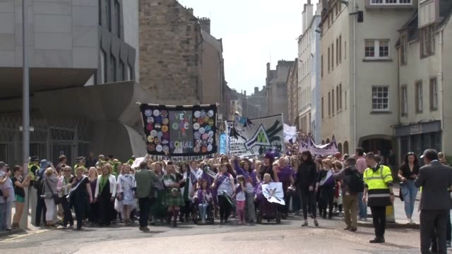 contains strong language hundreds of women takepart in the processions parade to mark 100 years since the first women in britain got the vote going... - royal mile stock videos and b-roll footage