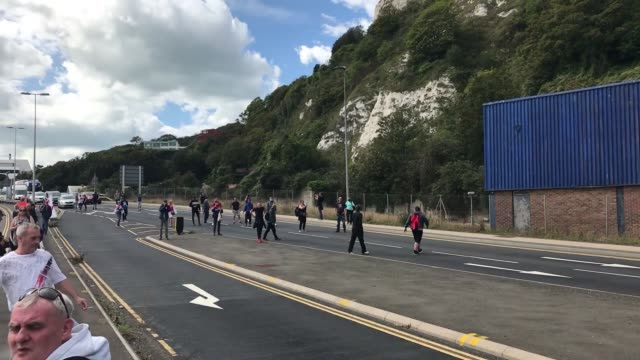 **caution, contains swearing and offensive language**. anti-migrant protesters have clashed with police and blocked a dual carriageway. rival groups... - small stock videos & royalty-free footage