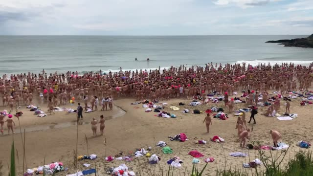 caution nudity hundreds of women take part in the annual strip and dip in co wicklow to raise money for cancer charities interviews wirh ashley... - naked stock videos & royalty-free footage