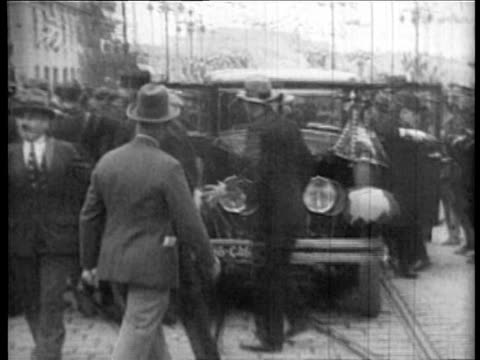 Cavalry in parade before car with King Alexander French Foreign Minister Barthou at assassination / police surround car / CU man with pistol used /...