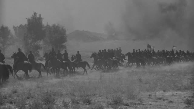 ws pan cavalry moving forward through fog in mountain area - battle stock videos & royalty-free footage