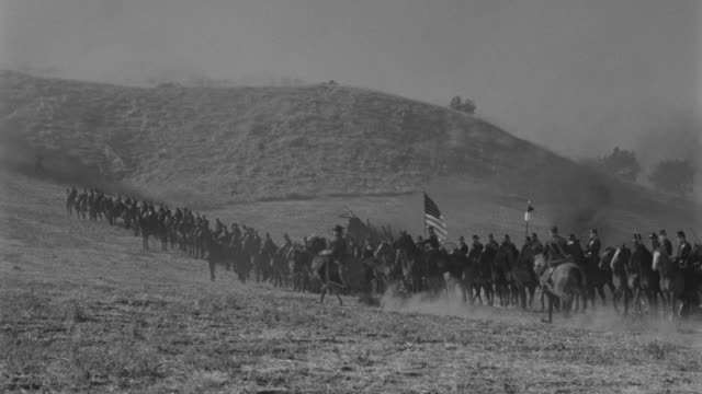 ws pan cavalry moving forward through fog in mountain area - cavalry stock videos & royalty-free footage