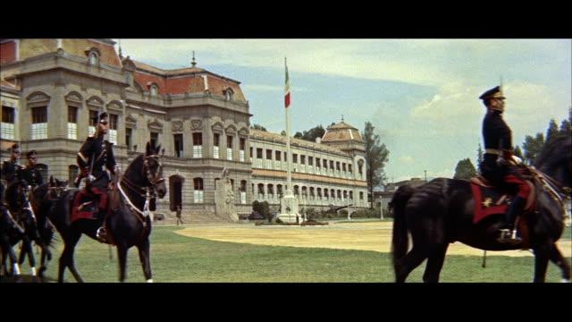 ms cavalry passing / mexico - anno 1957 video stock e b–roll