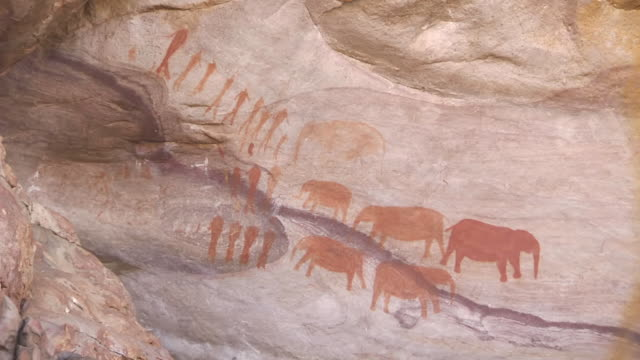 cu cave paintings of people and elephants in cederberg mountains / western cape, south africa - cave painting stock videos & royalty-free footage