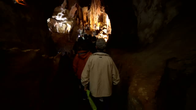 cave visitors - cave stock videos & royalty-free footage