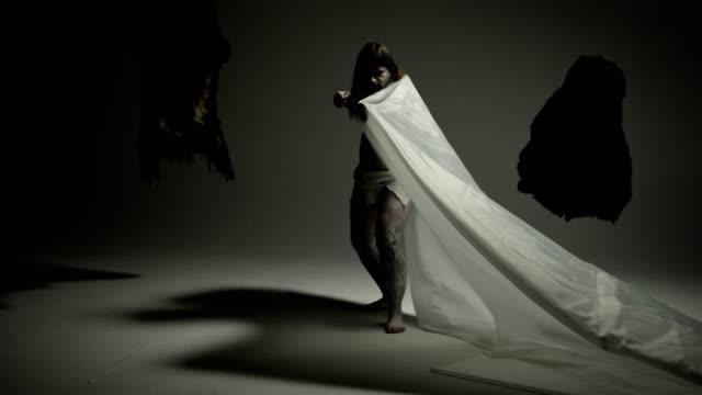 caveman. modern art freeze pose. - guerriero video stock e b–roll