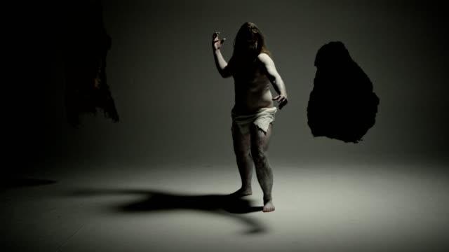 Caveman - modern art. Freeze pose.