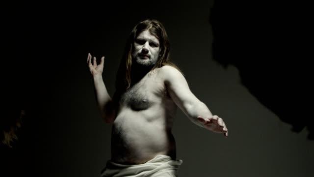 caveman - modern art. freeze pose. - ancient history stock videos & royalty-free footage
