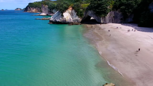 cavern, cathedral cove, cliffs, beach, rocks, sea, coromandel, - cathedral rocks stock videos & royalty-free footage