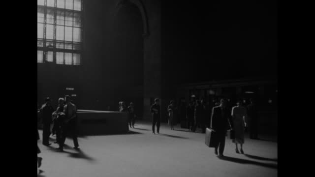vs cavernous train station / vs people approach building with huge columns / porters and passengers in same station / vs locomotive slowly moving... - lokomotive stock-videos und b-roll-filmmaterial