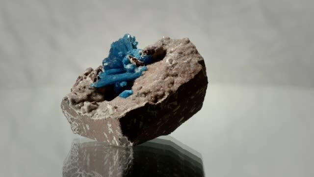 Cavernsite rotating on white