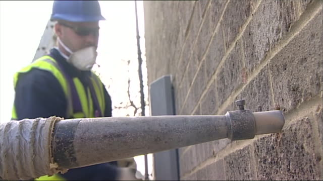 cavity walls being filled - construction worker stock videos & royalty-free footage