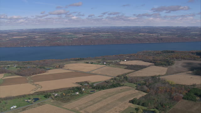 aerial cayuga lake and the surrounding farmland / ithica, new york, united states - cayuga stock videos & royalty-free footage