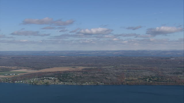 aerial cayuga lake and the surrounding farmlands / new york, united states - cayuga stock videos & royalty-free footage