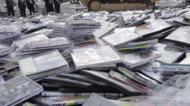 cds and dvds being destroyed for piracy protection - dvd stock videos & royalty-free footage