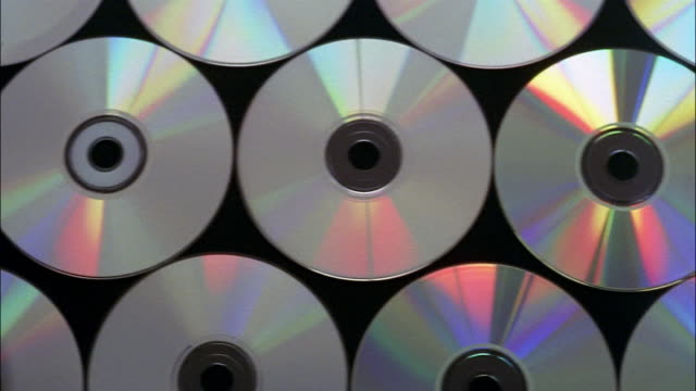 stockvideo's en b-roll-footage met cds cover a black background. - dvd