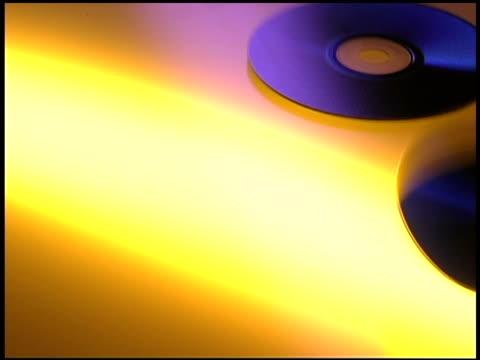cds falling in studio shot - 少数の物点の映像素材/bロール