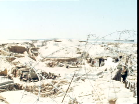 cease fire along suez canal enters third day israel suez canal soldier and gun lr to more then to snow in army kit and helmet sof 'the ceasefire here... - skibrille stock-videos und b-roll-filmmaterial