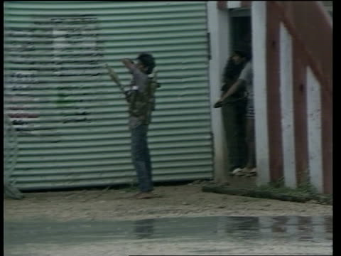 ceasefire agreement sri lanka nr jaffna ms tamil tigers carrying rifles along towards ms tiger loading rocket launcher as other men run under... - sri lanka stock videos and b-roll footage