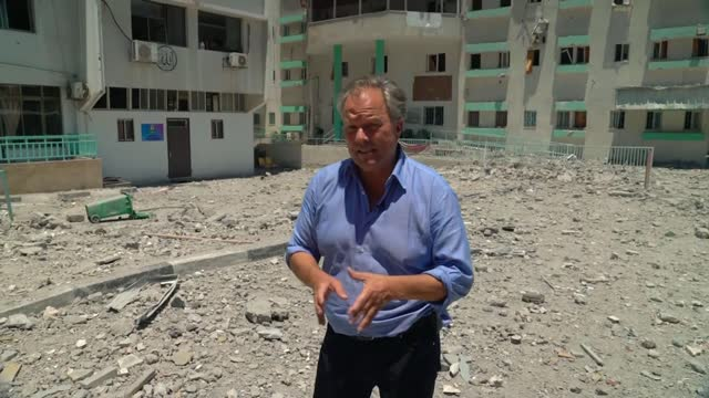 ceasefire between israel and hamas has held for a fourth day; gaza; various shots of rubble of buildings destroyed by airstrikes, people along at... - ガザ地区点の映像素材/bロール
