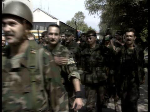 croatia osijek ms croatian soldiers walking along towards cms ditto as make 2finger salute ms soldiers along towards ms croatians singing fascist... - 旧ユーゴスラビア点の映像素材/bロール