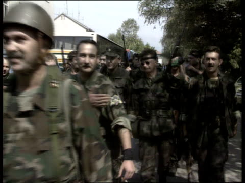 croatia osijek ms croatian soldiers walking along towards cms ditto as make 2finger salute ms soldiers along towards ms croatians singing fascist... - waffenruhe stock-videos und b-roll-filmmaterial
