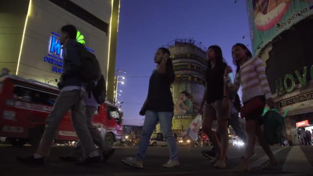 Cebu city Colon street at night b-roll low angle view, Philippines